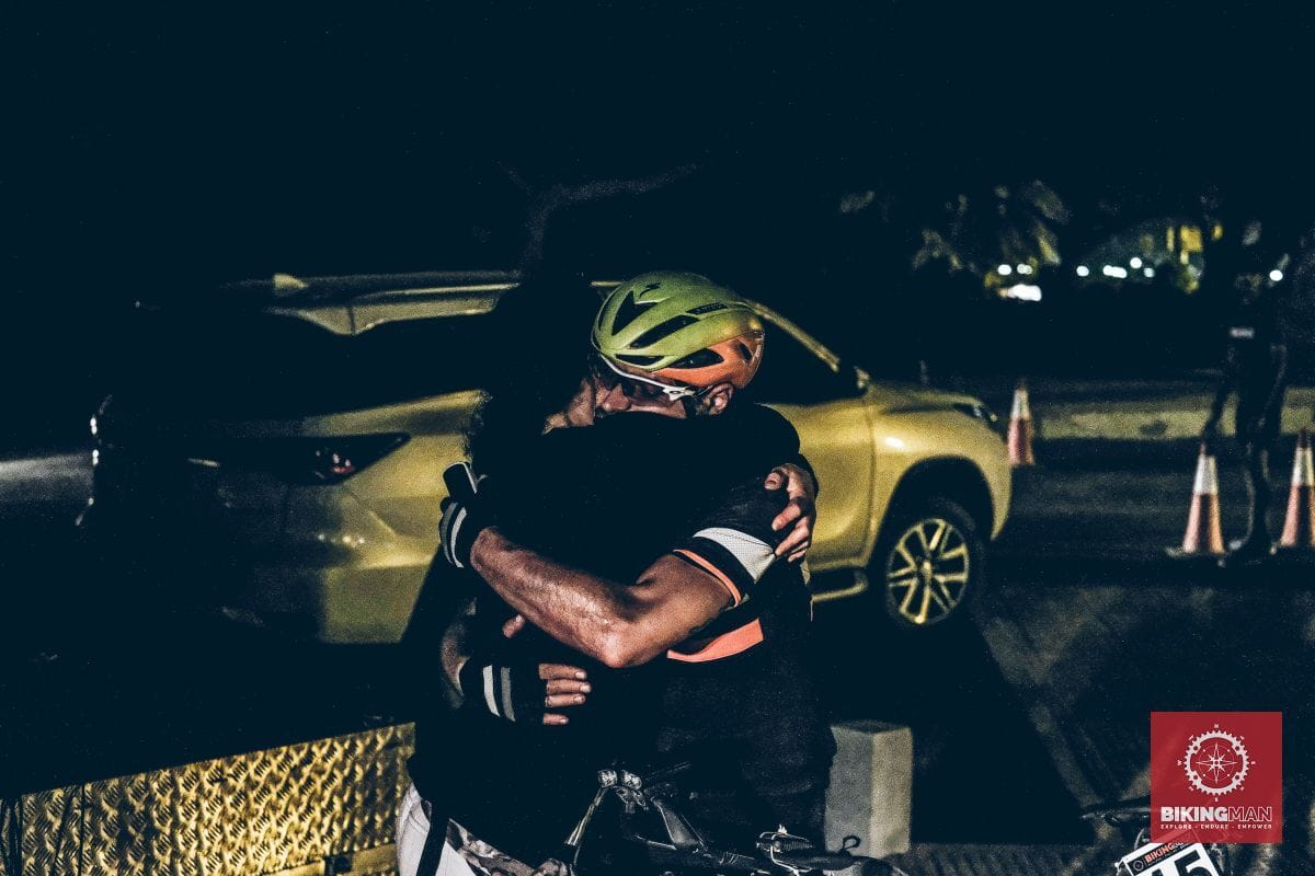 Welcome hug at the finish line in Oman
